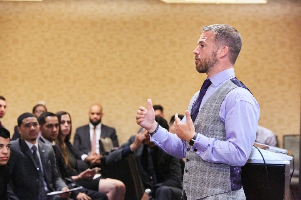John Sabastian Enges teaching business management program.